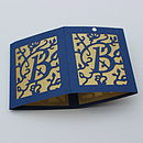 Blue shade with gold vellum, packed flat for mailing