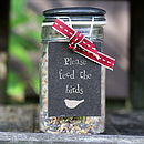 Thumb jar of wild bird seed