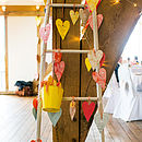 Why not hang them on a ladder for guest messages?