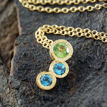 Gold Peridot And Topaz Graduating Pendant