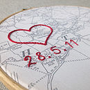 Vintage map in hoop with embroidered heart and date in cursive font