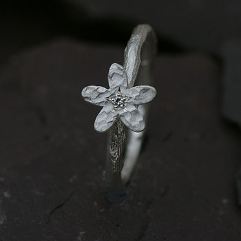 Flower Ring In Silver Set With A Diamond