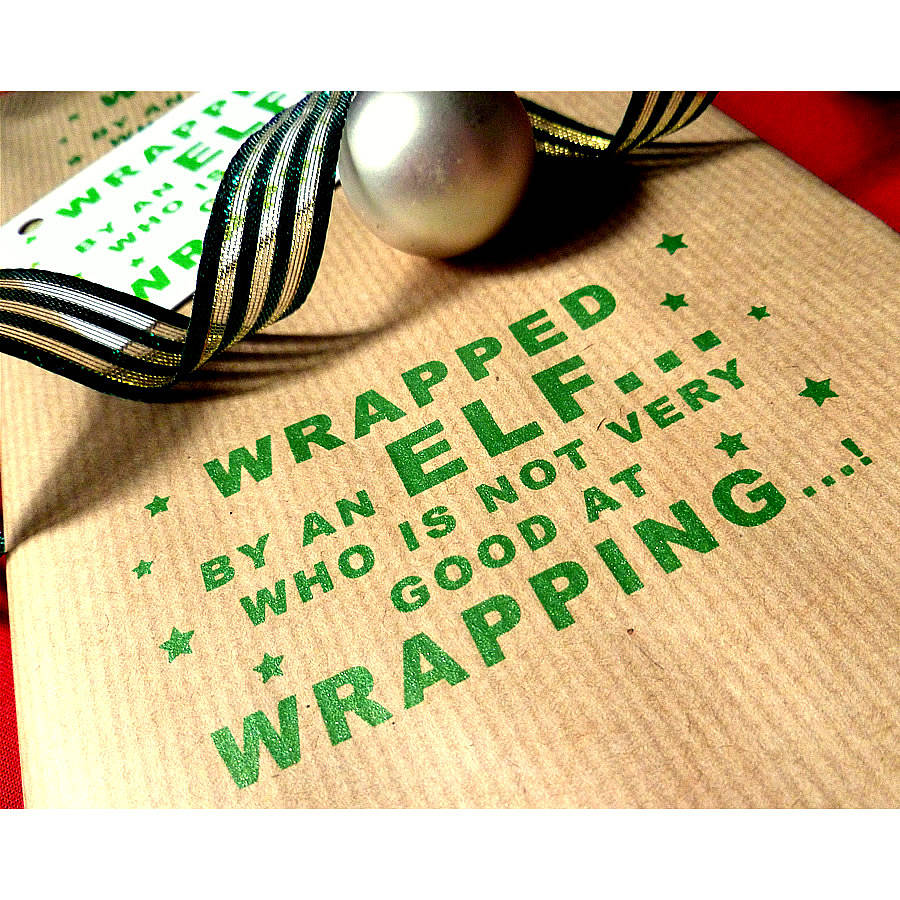 handmade clumsy elf! christmas wrapping paper by indigoelephant