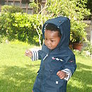 Baby Emma, 15 months blue raincoat
