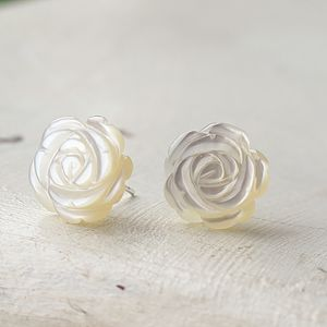 A Pair Of Mother Of Pearl Carved Flower Studs - earrings
