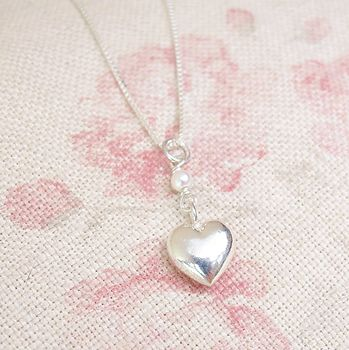 A Small Sterling Silver Heart Pearl Pendant