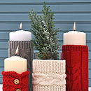 left to right: buttoned red, long light grey, short cream and long red cosies