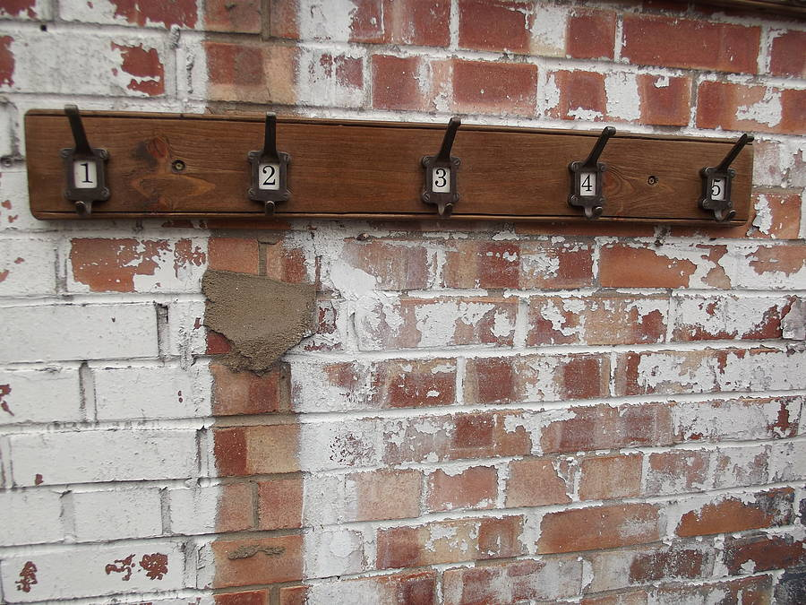 Row of five factory hooks by woods vintage home interiors - Cast iron row of hooks ...