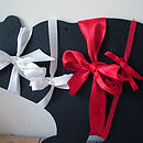 White satin, white grosgrain, red satin, res grosgrain ribbon samples