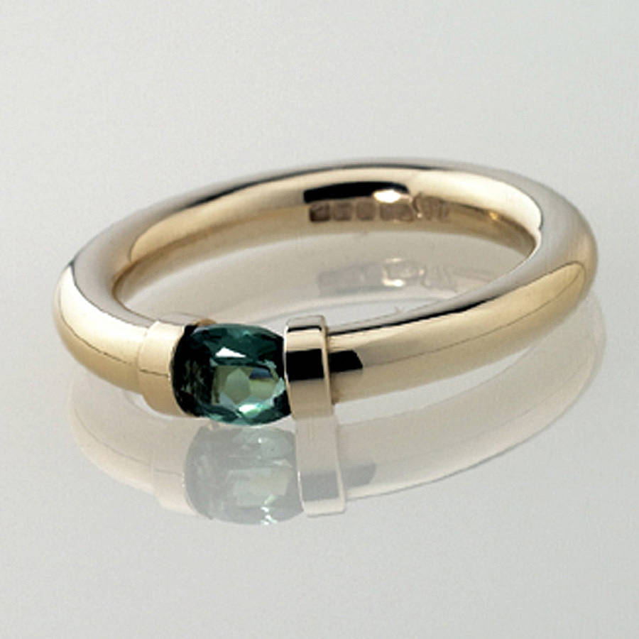 Tension Set Gold Ring With Green Tourmaline