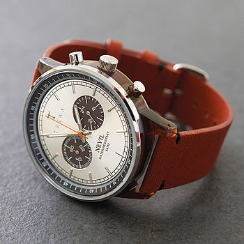 Brown strap/ silver face