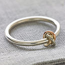 Silver ring with gold knots