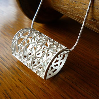 Pillow pendant in silver with tucked stitch design
