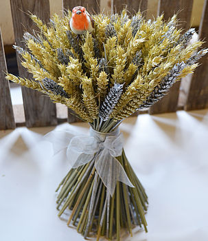 Christmas wheat sheaf with natural and silver wheat. Decorative ribbon is silver and robin decoration