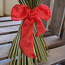Red decorative ribbon. Also comes in silver and gold.