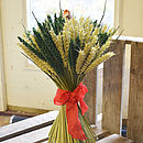 Christmas wheat sheaf with natural wheat and green wheat, tied with a red decorative ribbon and including decorative robin.