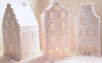 A Set Of Ceramic House Tea Light Holders