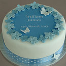Christening cake decorating kit with blue polka dot ribbon