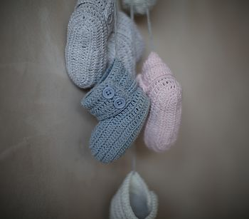 Baby booties available in soft grey, cream, vintage pink and dusky blue