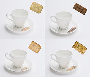 Set Of Four Biscuit Design Cups And Saucers