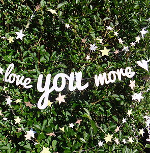 'Love You More' - signs