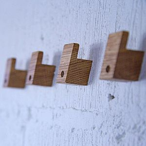 A Set Of Four Wooden Coat Hooks - home accessories