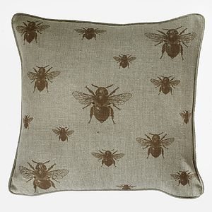 Rust Repeating Bee Cushion On Natural Linen - bedroom