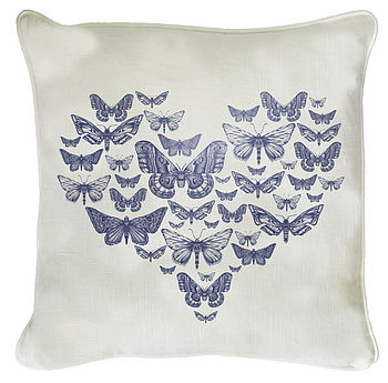 Blue Butterfly Heart Cushion On White Linen