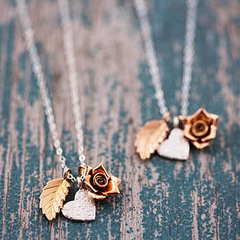 Silver chain with rose gold veined leaf, hammered heart and rose gold rose charms