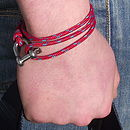 red cord with blue fleck friendship bracelet