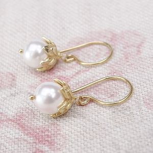 A Pair Of Pearl And Flower Earrings - bridal earrings