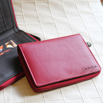 Red leather with example of handwritten engraving, long side of the wallet
