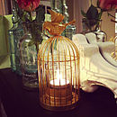 Gold bird cage candle holder