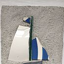 Small Boat With Blue Striped Sail