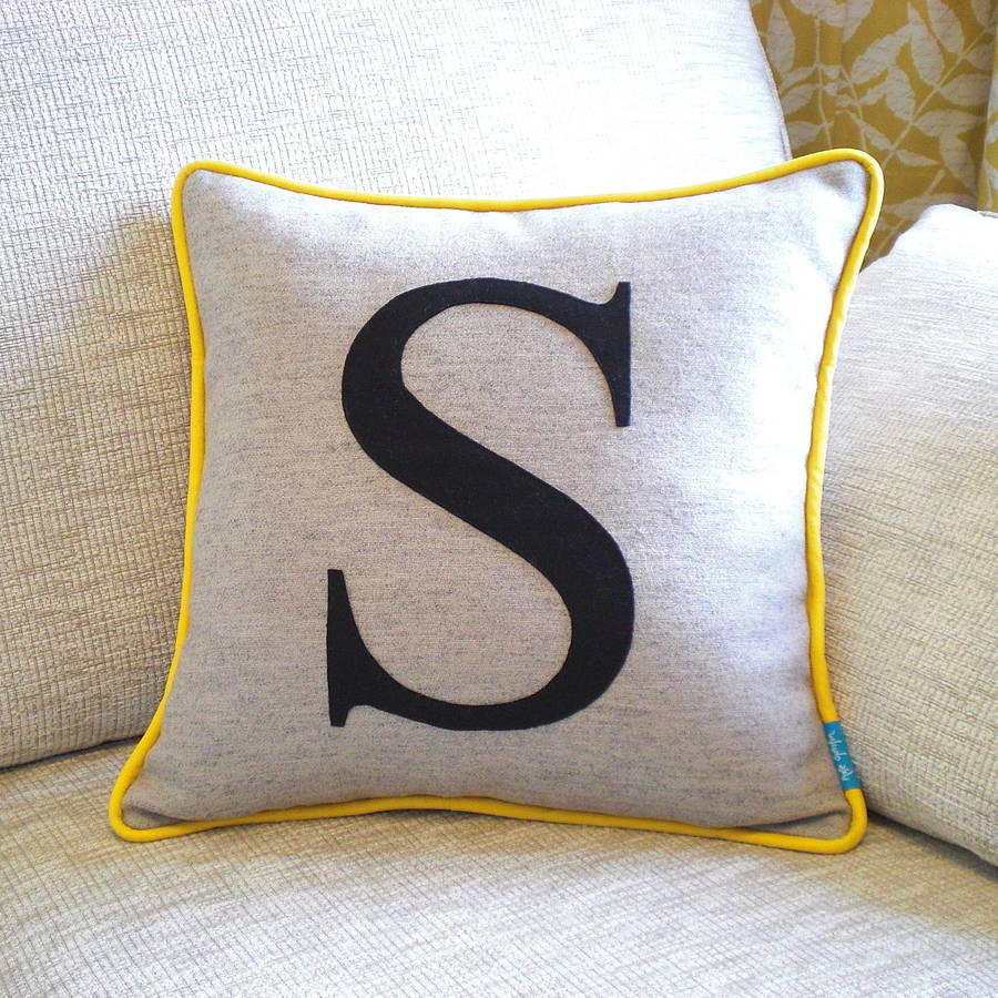 piped edge initial cushion by kate sproston design