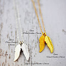 Gold and silver chains and feather charms