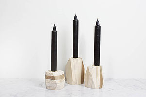 A Set Of Three Geometric Candle Holders