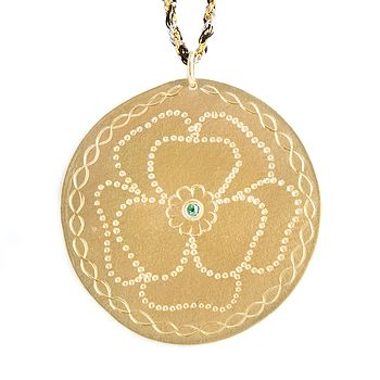 "18ct gold ""Camelia"" medal with Emerald set stone on silver gold plated chains braided with black coloured yards"