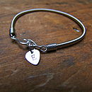 ladies bracelet with plectrum charm