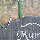 Wire rope hanger on oval slate sign