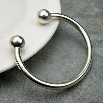 Mans torque bracelet balls