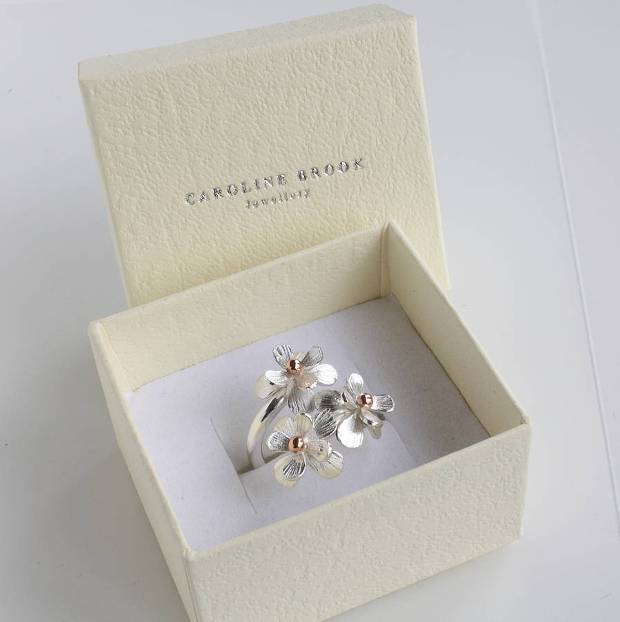 Silver and rose gold daisy flower ring by caroline brook silver and rose gold daisy flower ring izmirmasajfo