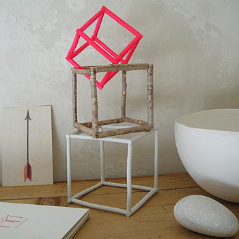 Set of three twig cubes with small pink cube