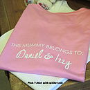 Pink T-shirt with white text