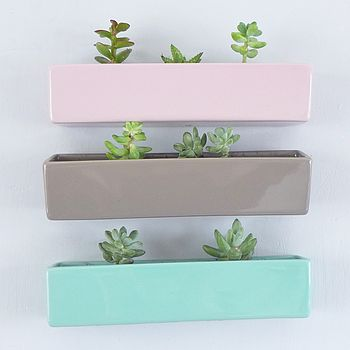 From top to bottom: pale pink, pale grey and seafoam green ceramic wall brick planter