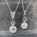 single white pearl pendant with silver heart