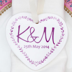 A Set Of Monogrammed Heart Favours - wedding favours