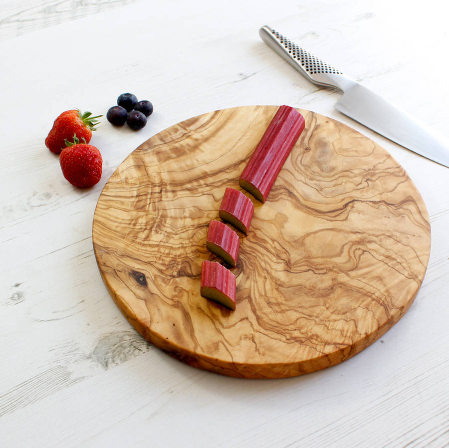 Wooden Cheese Boards ~ Round olive wood cheese or chopping board by the rustic