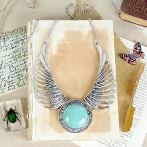 Winged Turquoise Necklace In Silver - statement jewellery