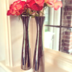 Two Polished Black Candlesticks And Vases - vases